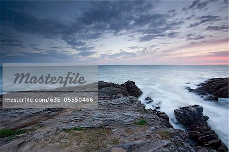 Rocks jutting into ocean under sky Stock Photo - Premium Royalty-Free, Image code: 635-05550466