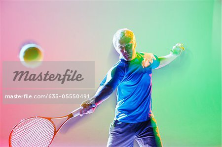 Blurred view of tennis player swinging