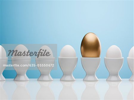 Golden egg in egg cup Stock Photo - Premium Royalty-Free, Image code: 635-05550672