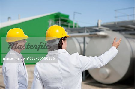 Scientists examining tanks outdoors Stock Photo - Premium Royalty-Free, Image code: 635-05550836