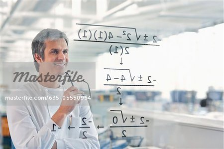 Scientist using touch screen in lab Stock Photo - Premium Royalty-Free, Image code: 635-05550964
