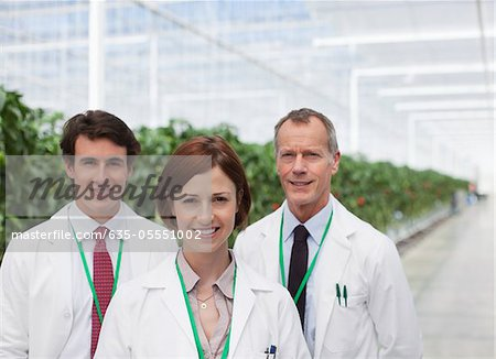 Scientists smiling in greenhouse Stock Photo - Premium Royalty-Free, Image code: 635-05551002