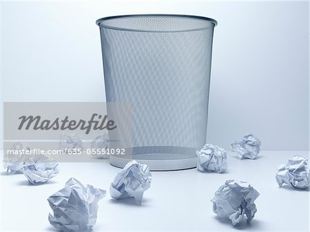 Crumpled balls of paper beside wastebasket Stock Photo - Premium Royalty-Free, Image code: 635-05551092