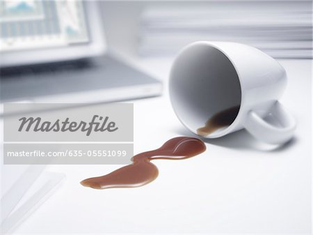 Coffee spilled on office desk Stock Photo - Premium Royalty-Free, Image code: 635-05551099