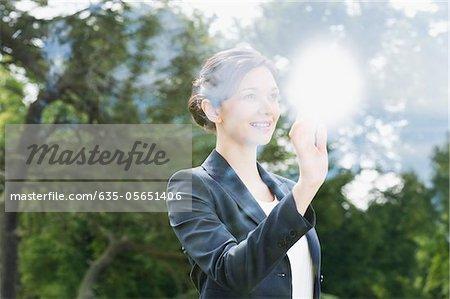 Businesswoman looking out window Stock Photo - Premium Royalty-Free, Image code: 635-05651406