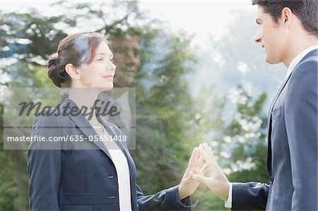 Business people looking at each other through glass Stock Photo - Premium Royalty-Free, Image code: 635-05651418