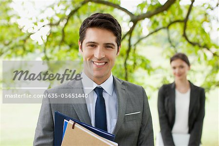 Business people standing together outdoors Stock Photo - Premium Royalty-Free, Image code: 635-05651440