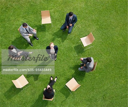 Business people having meeting outdoors Stock Photo - Premium Royalty-Free, Image code: 635-05651449