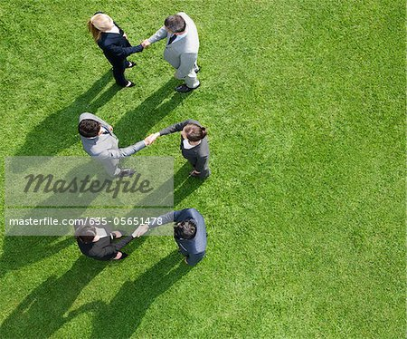 Business people shaking hands together outdoors Stock Photo - Premium Royalty-Free, Image code: 635-05651478