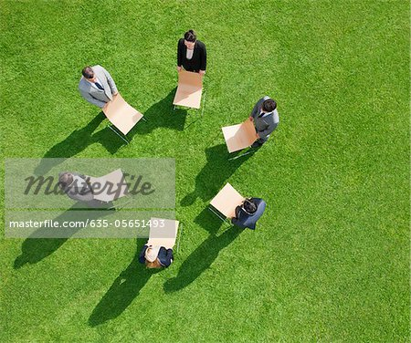 Business people in outdoor meeting standing in circle Stock Photo - Premium Royalty-Free, Image code: 635-05651493