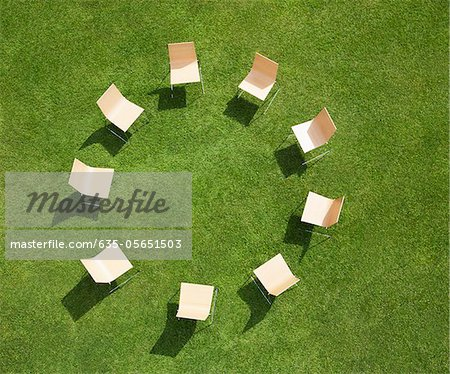 Chairs in circle formation on grass Stock Photo - Premium Royalty-Free, Image code: 635-05651503