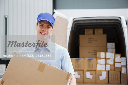 Deliveryman carrying box from van Stock Photo - Premium Royalty-Free, Image code: 635-05651535