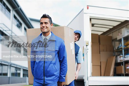 Deliverymen carrying large box from van Stock Photo - Premium Royalty-Free, Image code: 635-05651545