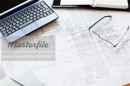 Blueprint, laptop and eyeglasses in office Stock Photo - Premium Royalty-Free, Image code: 635-05651547