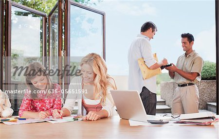 Man signing for package Stock Photo - Premium Royalty-Free, Image code: 635-05651591