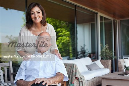 Smiling couple relaxing together on patio Stock Photo - Premium Royalty-Free, Image code: 635-05651746