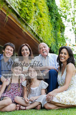 Smiling family relaxing together on grass Stock Photo - Premium Royalty-Free, Image code: 635-05651778