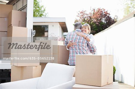 Couple hugging near boxes and moving van Stock Photo - Premium Royalty-Free, Image code: 635-05652138