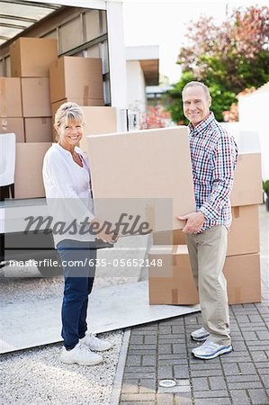 Couple unloading boxes from moving van Stock Photo - Premium Royalty-Free, Image code: 635-05652148