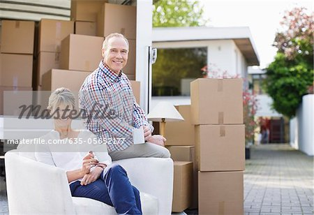 Couple sitting with moving and boxes Stock Photo - Premium Royalty-Free, Image code: 635-05652177