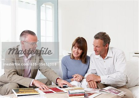 Interior designer showing samples to customers Stock Photo - Premium Royalty-Free, Image code: 635-05652308