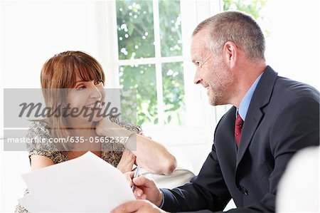 Financial advisor talking to customer Stock Photo - Premium Royalty-Free, Image code: 635-05652327