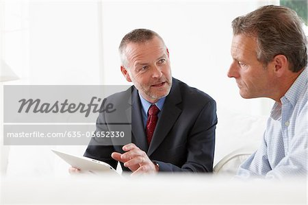Financial advisor talking to customer Stock Photo - Premium Royalty-Free, Image code: 635-05652330