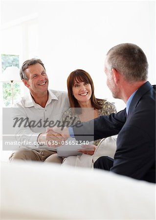 Financial advisor shaking hands with customers Stock Photo - Premium Royalty-Free, Image code: 635-05652340