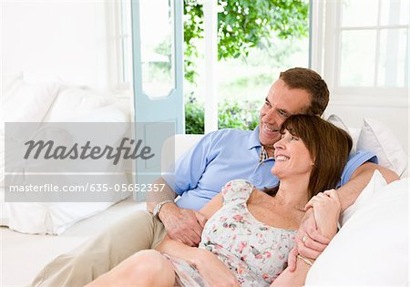 Couple reclining on sofa together Stock Photo - Premium Royalty-Free, Image code: 635-05652357