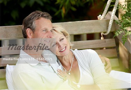 Couple sitting outdoors hugging Stock Photo - Premium Royalty-Free, Image code: 635-05652371