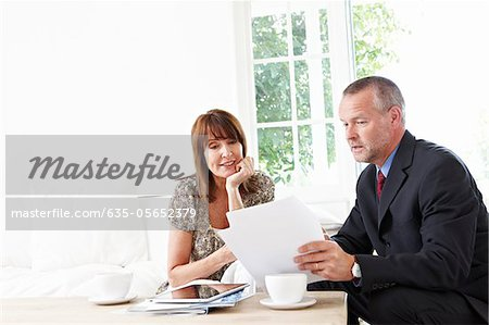 Financial advisor explaining paperwork to customer Stock Photo - Premium Royalty-Free, Image code: 635-05652379