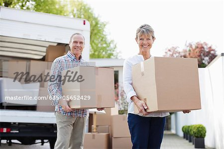 Couple unloading boxes from moving van Stock Photo - Premium Royalty-Free, Image code: 635-05652429