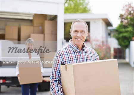 Couple unloading boxes from moving van Stock Photo - Premium Royalty-Free, Image code: 635-05652435