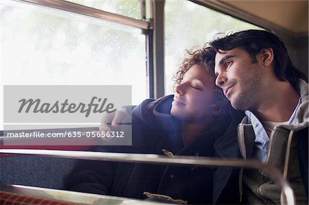 Serene couple hugging on bus Stock Photo - Premium Royalty-Free, Image code: 635-05656312