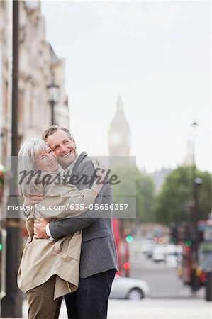 Happy couple hugging in London Stock Photo - Premium Royalty-Free, Image code: 635-05656357