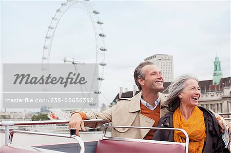 Happy couple riding double decker bus in London Stock Photo - Premium Royalty-Free, Image code: 635-05656392