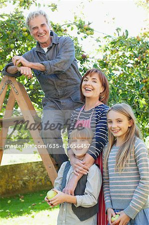 Smiling multi-generation family in apple orchard Stock Photo - Premium Royalty-Free, Image code: 635-05656457