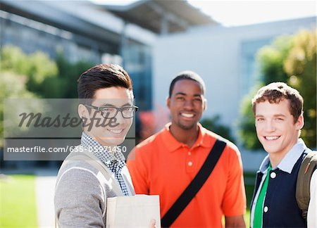 Smiling students standing outdoors Stock Photo - Premium Royalty-Free, Image code: 635-05971450