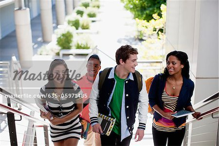 Students climbing steps together Stock Photo - Premium Royalty-Free, Image code: 635-05971485
