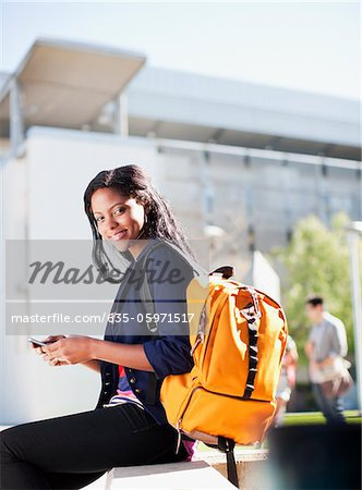 Student carrying backpack outdoors