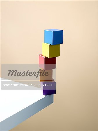 Stack of colorful cubes on table corner Stock Photo - Premium Royalty-Free, Image code: 635-05971580