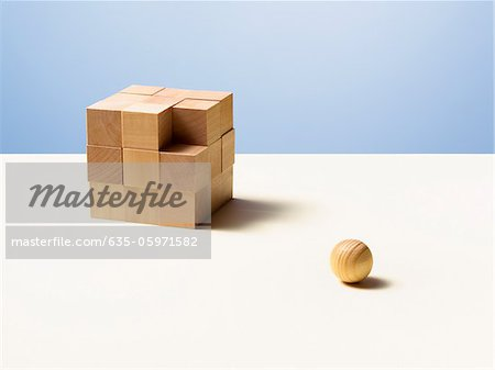 Wooden ball with wooden cube Stock Photo - Premium Royalty-Free, Image code: 635-05971582