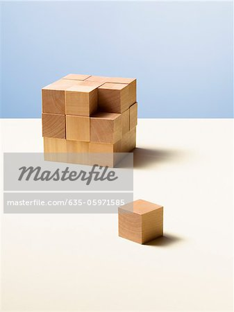 Piece of wooden cube separate from whole Stock Photo - Premium Royalty-Free, Image code: 635-05971585