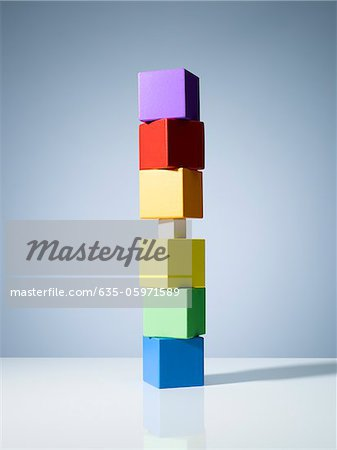 Tiny block in stack of colorful cubes Stock Photo - Premium Royalty-Free, Image code: 635-05971589