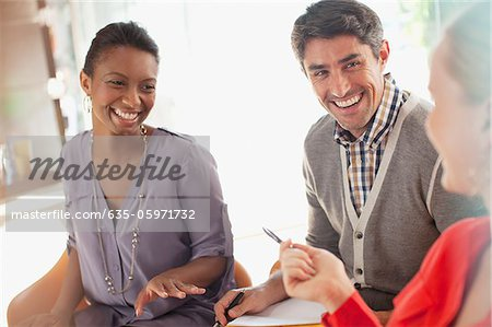Smiling business people working together Stock Photo - Premium Royalty-Free, Image code: 635-05971732