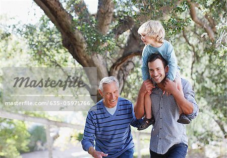 Three generations of men walking outdoors Stock Photo - Premium Royalty-Free, Image code: 635-05971766