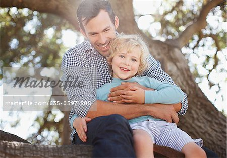 Father and son relaxing outdoors Stock Photo - Premium Royalty-Free, Image code: 635-05971805
