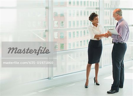 Business people shaking hands in office Stock Photo - Premium Royalty-Free, Image code: 635-05971860