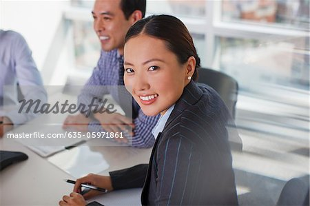 Businesswoman sitting in meeting Stock Photo - Premium Royalty-Free, Image code: 635-05971861
