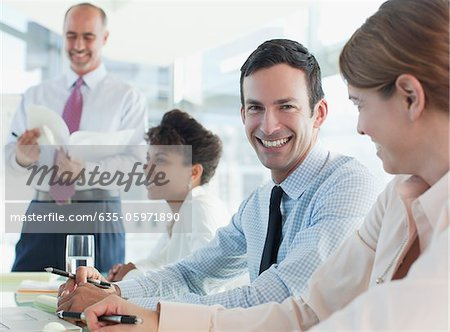 Business people talking in meeting Stock Photo - Premium Royalty-Free, Image code: 635-05971890